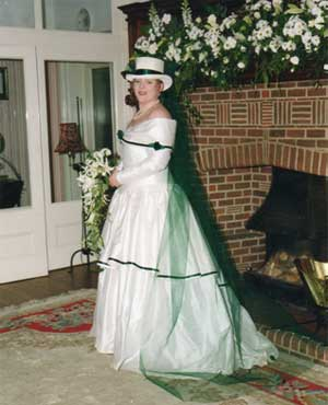 One of the Dunn daughters on her wedding day in front of the famous fireplace with inscription